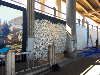 Photo of a local urban artist painting a mural under the I-70 viaduct during the 'duct-work Event (September 30, 2016).